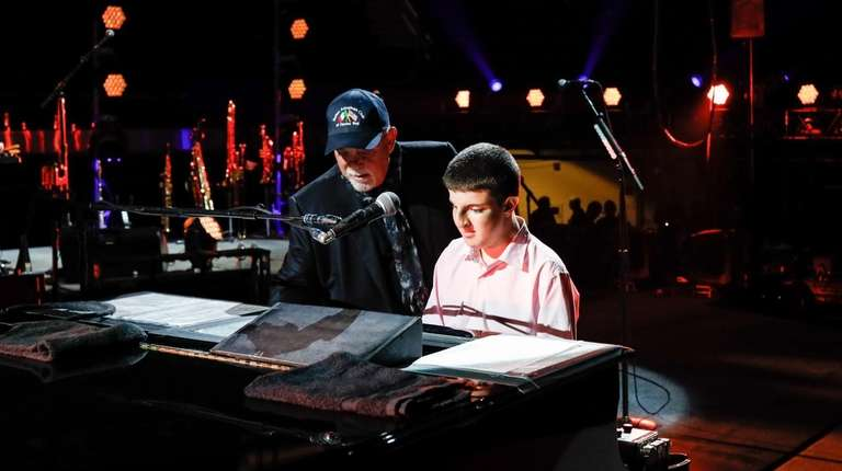 "Billy Joel and 14-year-old Logan Riman play ""Piano"