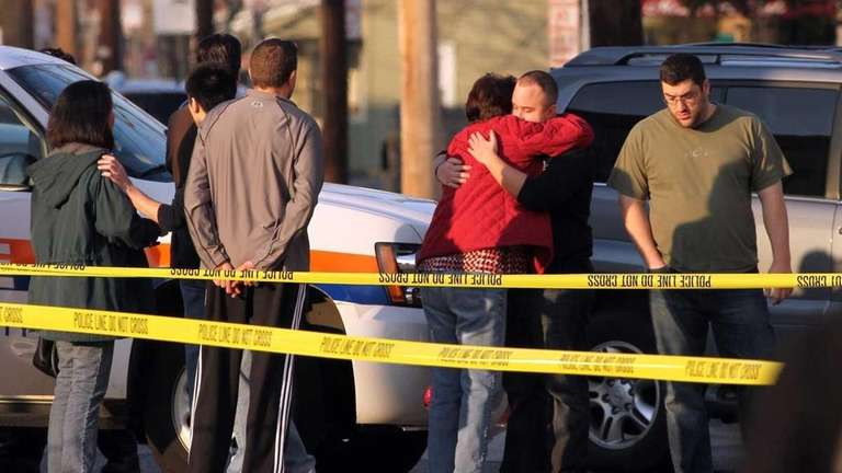 People console one and other at the scene