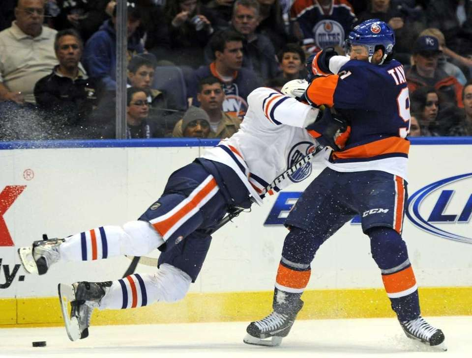 New York Islanders' John Tavares, right, collides with