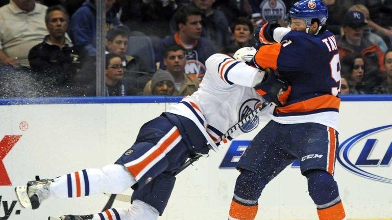 New York Islanders' John Tavares, right, collides with