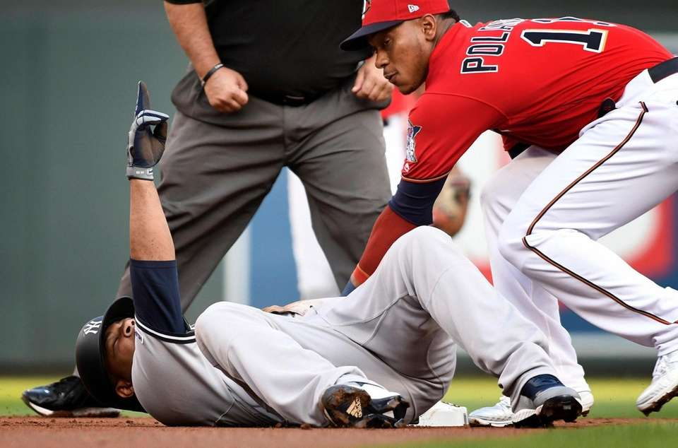 The Yankees' Edwin Encarnacion, left, lays at second