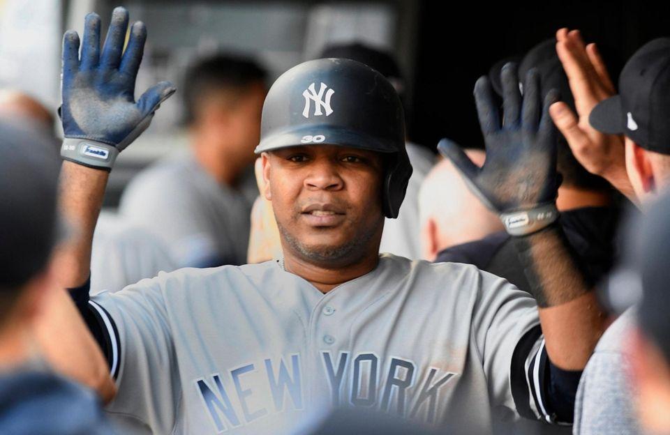 New York Yankees' Edwin Encarnacion celebrates in the
