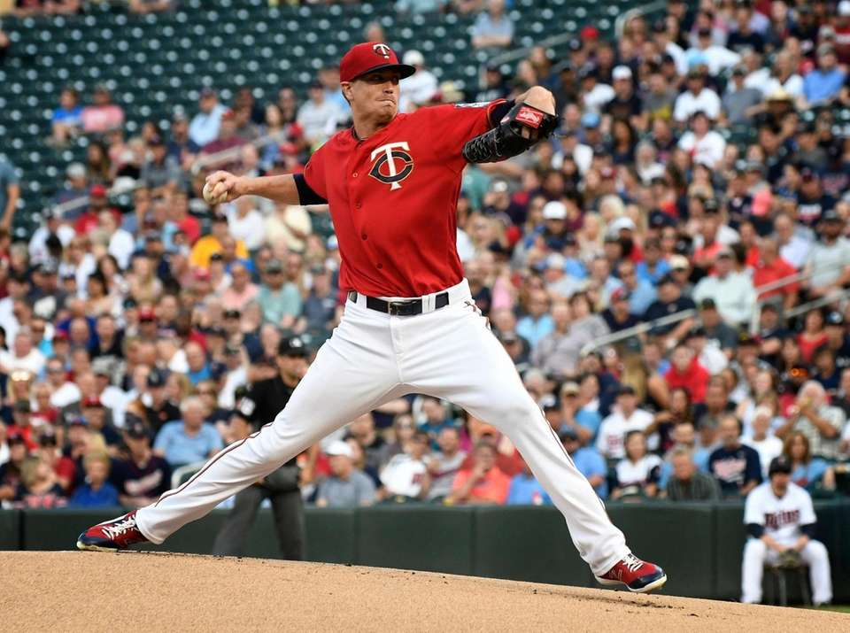 Minnesota Twins pitcher Kyle Gibson throws against the