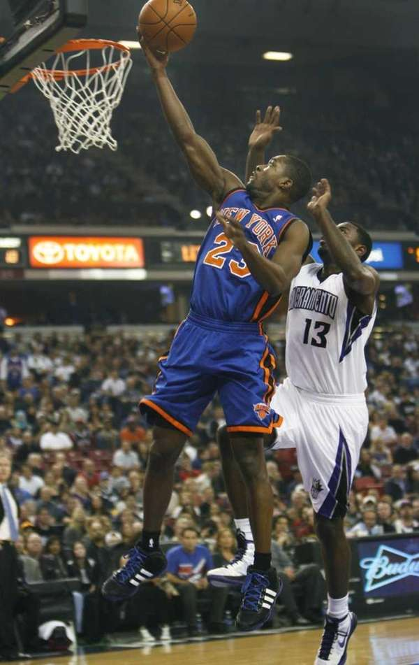 New York Knicks guard Toney Douglas drives to