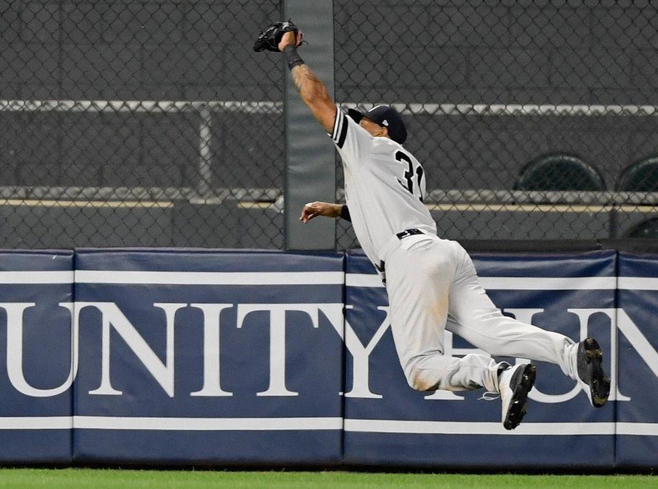 Yankees centerfielder Aaron Hicks makes a catch in