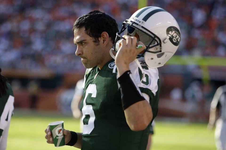 Jets quarterback Mark Sanchez stands on the sideline