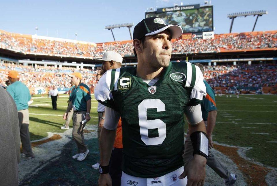 Jets quarterback Mark Sanchez walks off the field