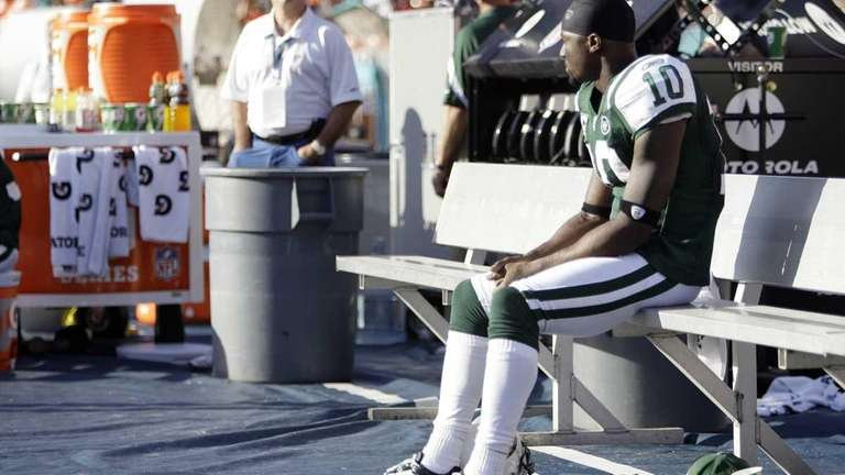 Jets wide receiver Santonio Holmes sits alone on