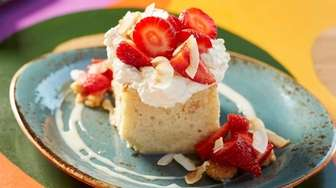 Coconut tres leches cake, with coconut custard, strawberries