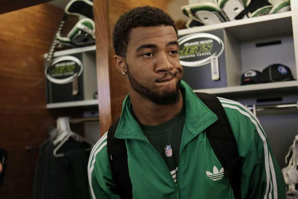 New York Jets' Aaron Maybin talks to reporters