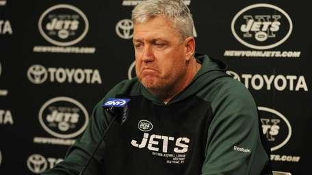 New York Jets head coach Rex Ryan ponders