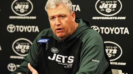 New York Jets head coach Rex Ryan holding