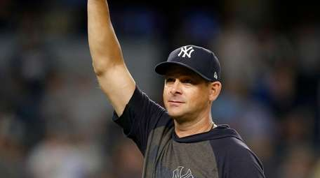 Manager Aaron Boone #17 of the Yankees gestures