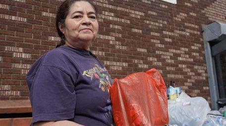 Maria Maribel Guzman of Brentwood carries bottles and