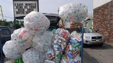 Angel Ortega of Brentwood brings bottles and cans