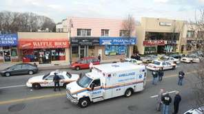 Police investigate the scene at Charlie's Family Pharmacy