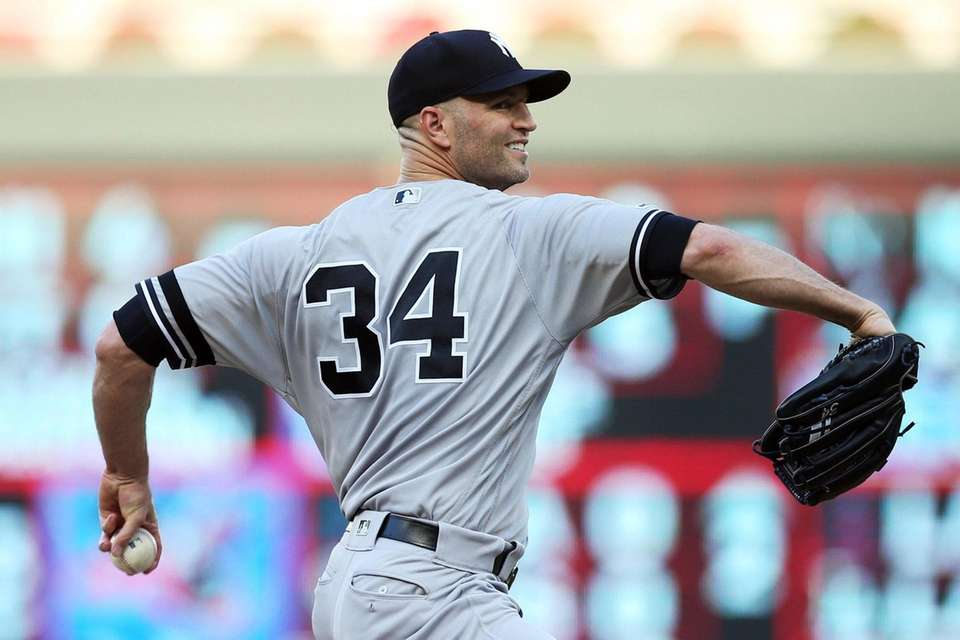 Yankees pitcher J.A. Happ delivers against the Twins
