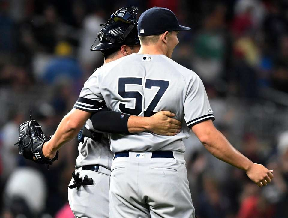 Yankees relief pitcher Chad Green gets a pat