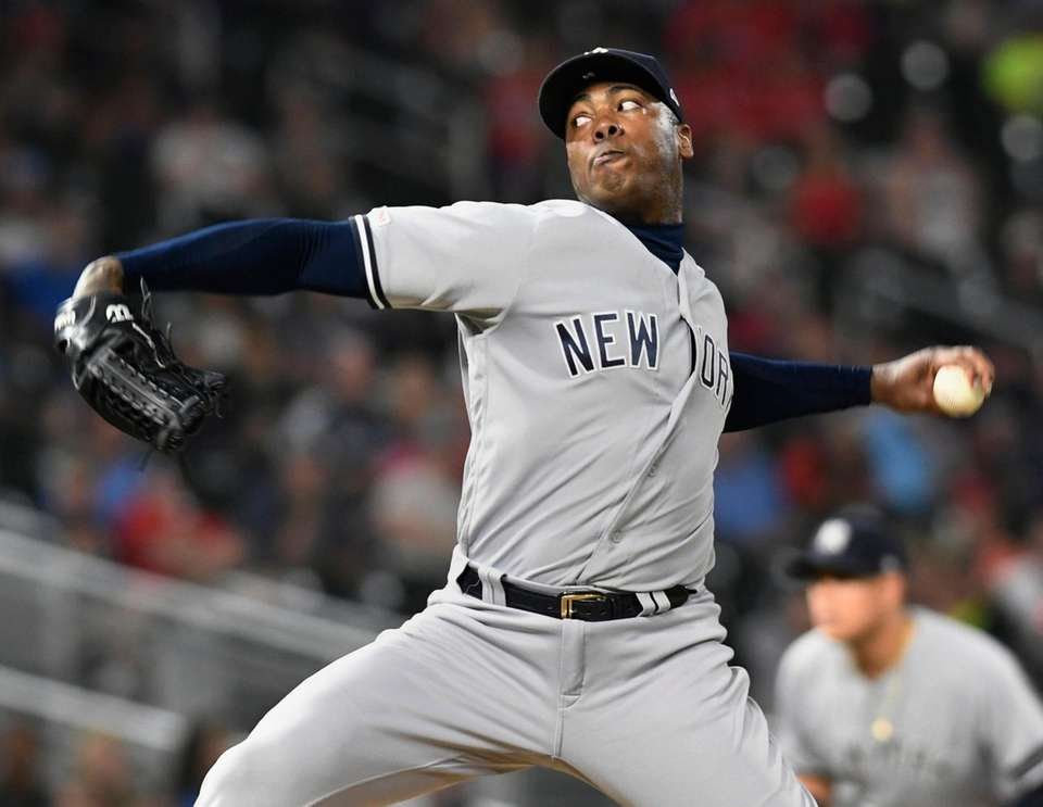 Yankees pitcher Aroldis Chapman delivers in the ninth