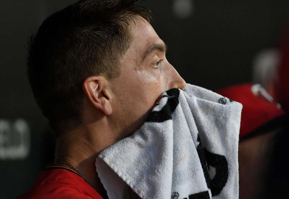 Twins pitcher Kyle Gibson wipes his face in