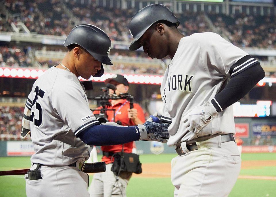 Yankees shortstop Gleyber Torres congratulates teammate Didi Gregorius