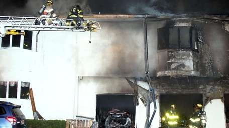 Flames started in the garage of a Linden