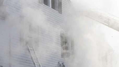 Volunteer firefighters battle a house fire in Valley