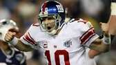 Quarterback Eli Manning reacts after he threw a