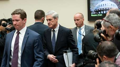 Escorted by a security detail, former special counsel