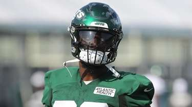 Jets running back Le'Veon Bell looks on during