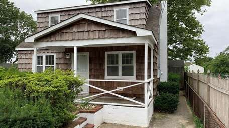 This Shirley home has three bedrooms and two