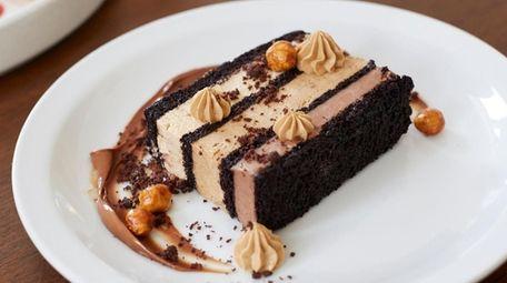 Chocolate cake with mocha mousse and whole hazelnuts