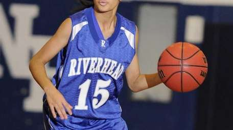 Riverhead guard Jalyn Brown controls the ball against