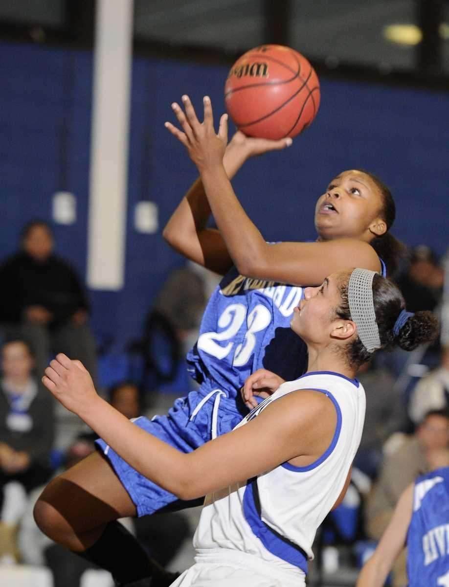 Riverhead guard Shanice Allen goes up for a