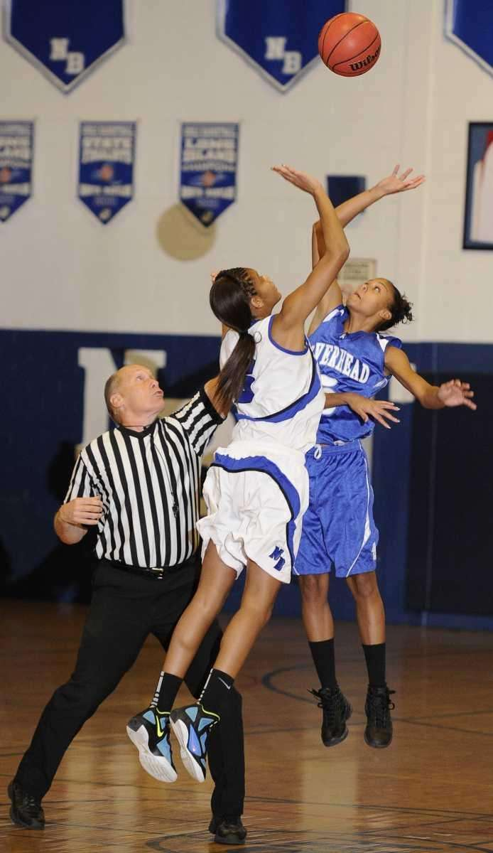 Riverhead forward Melodee Riley jumps for the opening