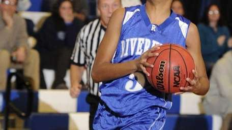 Riverhead forward Melodee Riley moves in for a