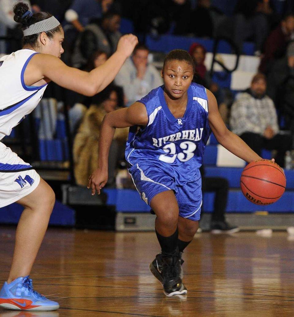 Riverhead guard Shanice Allen drives the ball against