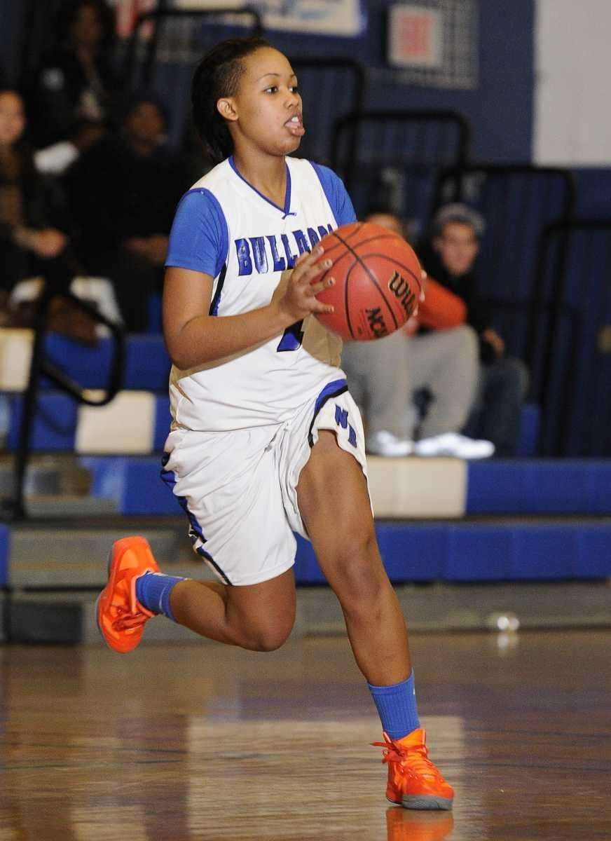 North Babylon guard Brittany Hicks looks to pass