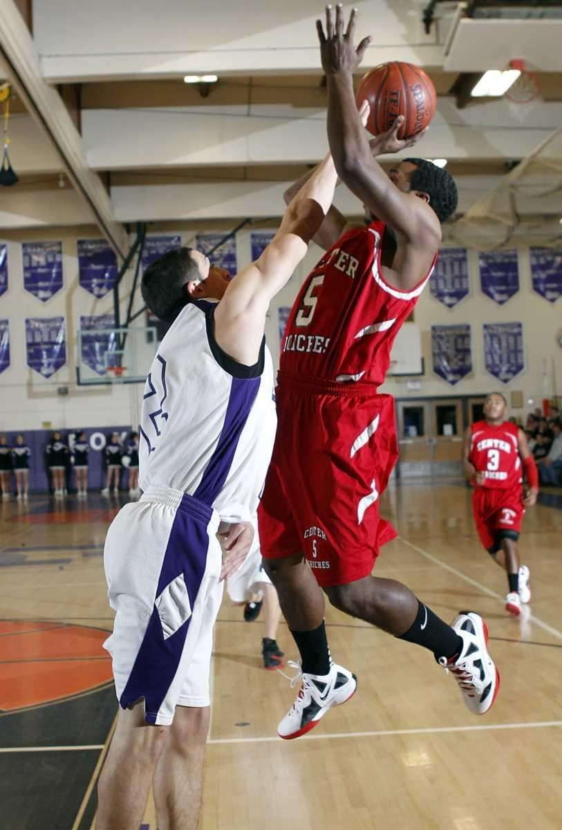 Center Moriches' Myles Bell (5) is fouled going