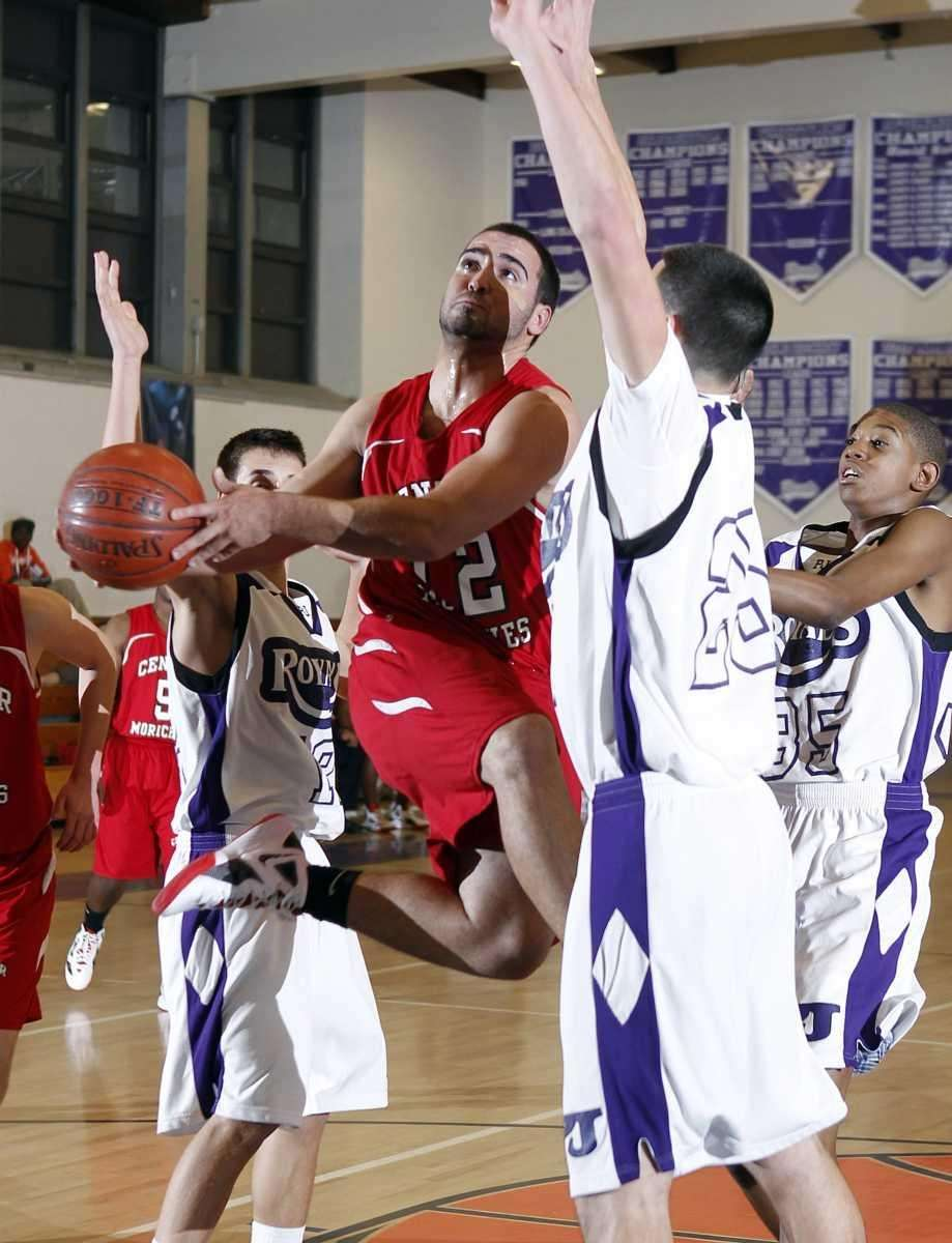 Center Moriches' Wayne Harris (12) with the scoop
