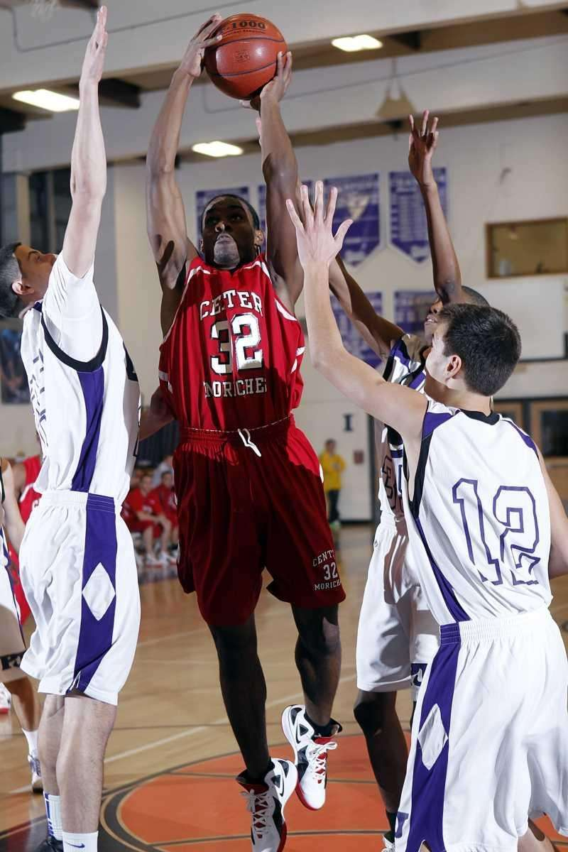 Center Moriches' Nequan Mathis (32) gets off the