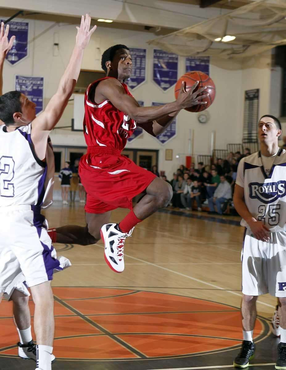Center Moriches' Maleek Harris (23) with the flying