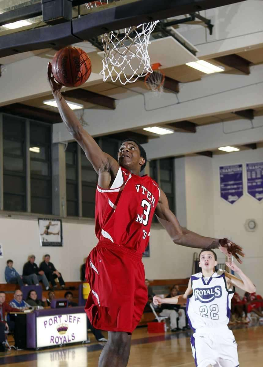 Center Moriches' Maleek Harris (23) scores after stealing