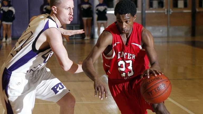 Center Moriches' Maleek Harris (23) drives against Port