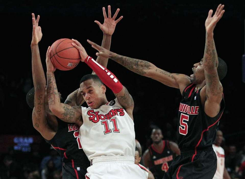 St. John's D'Angelo Harrison (11) is defended by