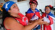 Maritza Rivera with daughters Steffani, center, 10, and