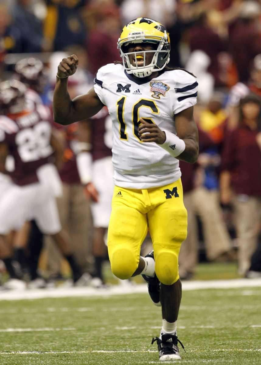 Michigan quarterback Denard Robinson celebrates after throwing a