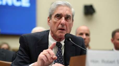 Former special counsel Robert Mueller testifies before the