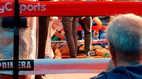 Argentine boxer Hugo Santillan is placed on a