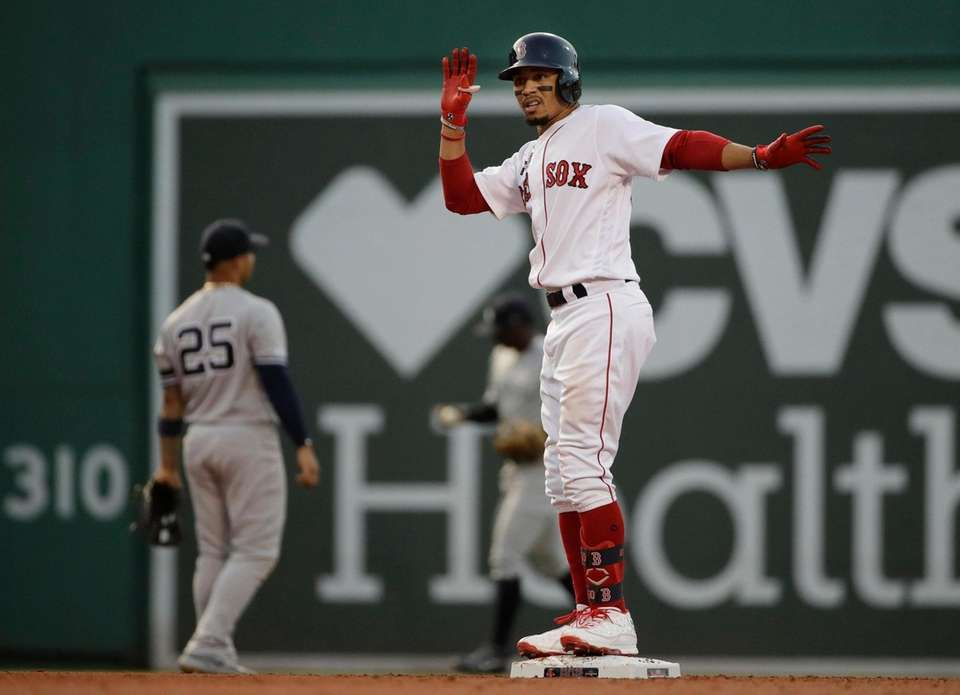 Boston Red Sox's Mookie Betts celebrates after hitting
